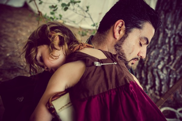 father and daughter sleeping at the ren faire