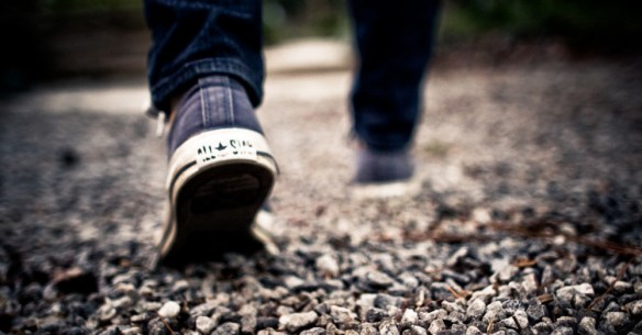 close up of a person's feet as they are walking as a symbol of us determining if we will walk with Jesus