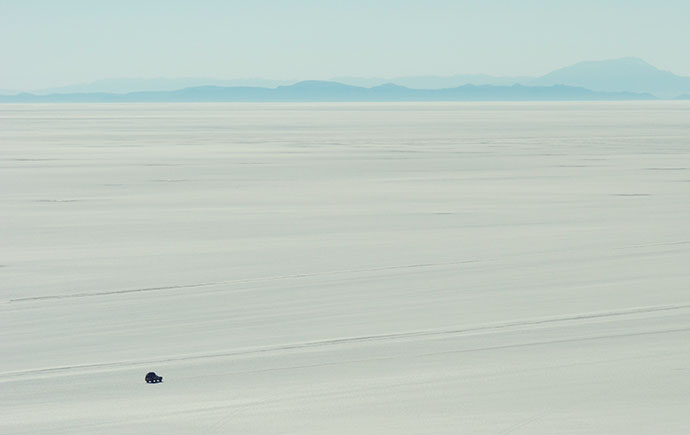 Tiny car on salt flats