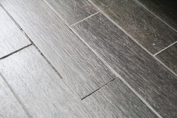 Tile floor in bathroom cracking wood floors for Hardwood floors popping