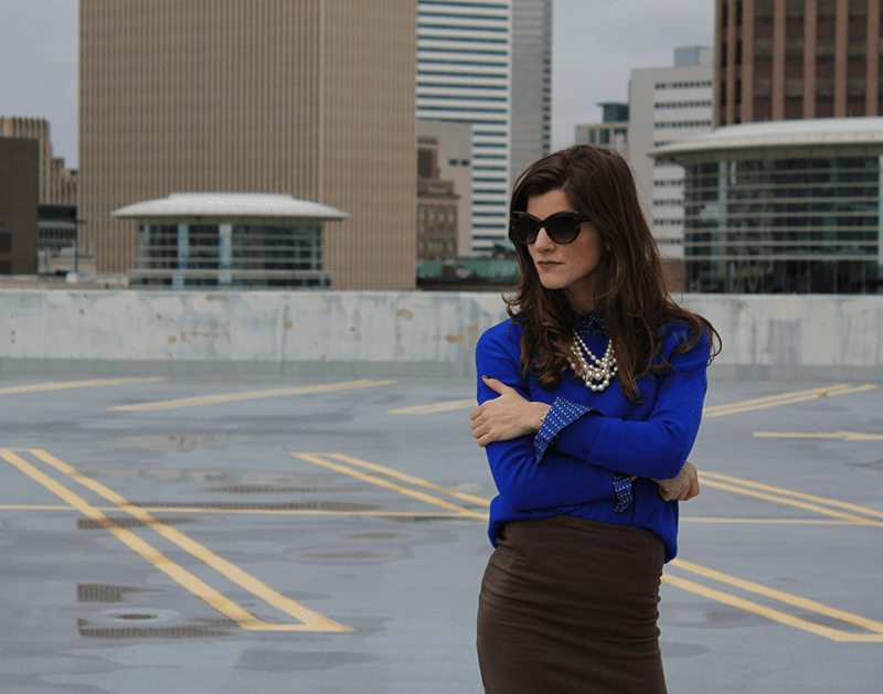 cobalt sweater and army green skirt work attire