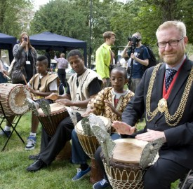 TRIBUTES: Cllr Mark Bennett with young residents in Clapham Park. Picture from Metropolitan Housing