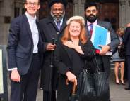 VICTORY: Club 414's Louise Barron and Anthony Pommell with their legal team outside the High Court
