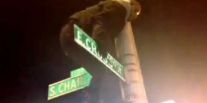 Guy's celebration in Baltimore ends with him falling off street signs