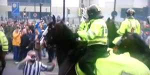 Newcastle fan tries to fight police horse during riot