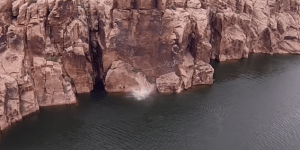 Cliff diver tries to paint sharp rocks with his brains, pulls off epic bellyflop instead