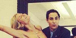 Here's Heidi Klum nearly naked with Zac Posen giving her a handbra