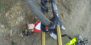 Watch this mountain biker run into an unexpected obstacle on the course — a kid!