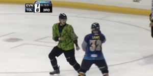Hockey Player Dressed As Batman Fights Hockey Player Dressed As The Riddler
