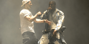 I'ma Let You Finish, But: Kanye Gets 'Taylor Swifted' At Glastonbury, Covers Queen And Is Trolled By Very Inappropriate Ray J Flag