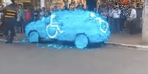Man Illegally Parks In Handicap Spot, Gets His Car Turned Into A Blue Piñata And Is Publicly Shamed