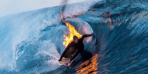 Surfer Lights Himself On Fire And Casually Catches Waves In Tahiti