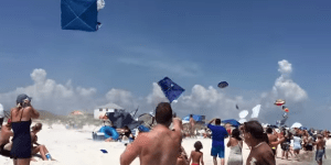 Most American Fly Over Ever: Blue Angel Buzzes So Close To Florida Beach It Sends Umbrellas Flying Everywhere