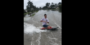 Frat Bros In Florida Tie A Tow Line To a Truck And Go Kneeboarding In Flood Waters