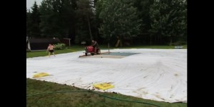 Redneck Water Skiing Involves A Tractor And A Wet Tarp, Looks Fantastic