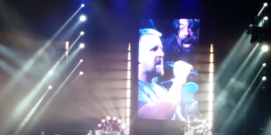 Dave Grohl Invites Foo Fighters Fan Onstage To Sing Rush's 'Tom Sawyer' And He Nailed It