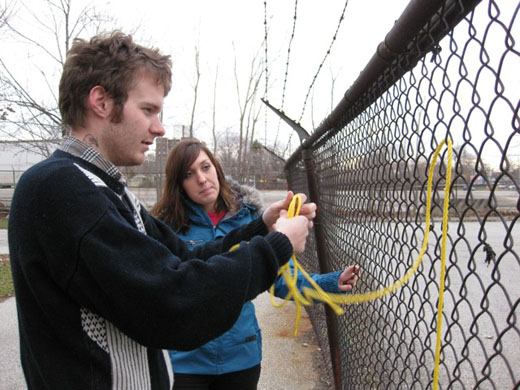 Steven and Michelle work out the logistics of the rope in the fence to create the R