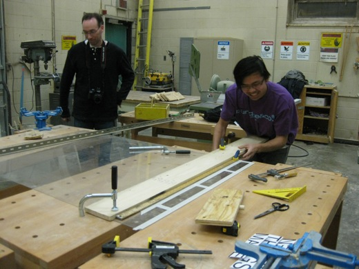 Immony clamps the plexiglass in the University of Windsor woodshop