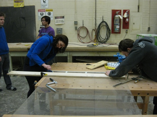 Michelle and Josh work to finish scoring the plexiglass