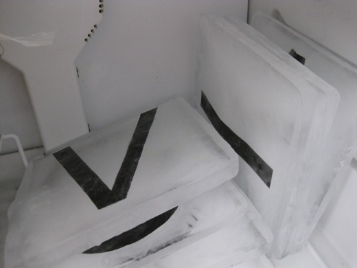 ice blocks with letters in the freezer