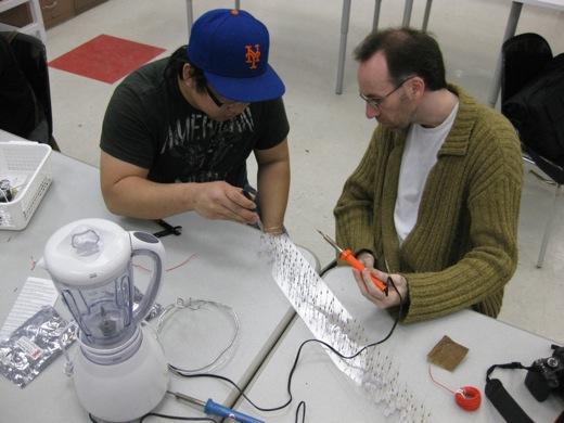 Mike and Darren soldering