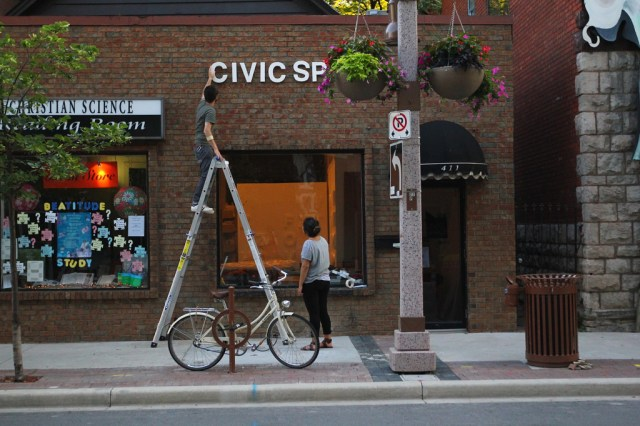 Installing some signage on the exterior wall of CIVIC SPACE (1)