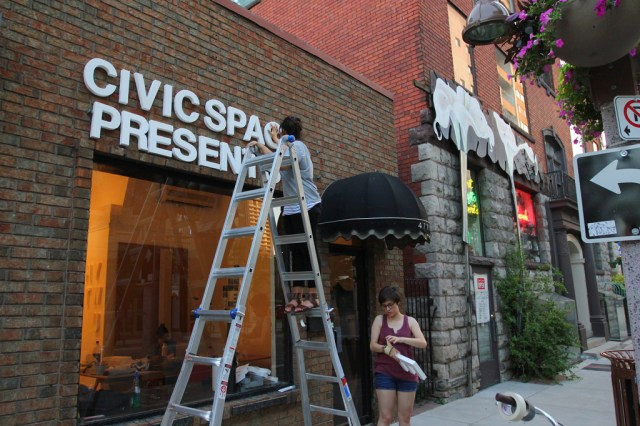 Installing some signage on the exterior wall of CIVIC SPACE (8)