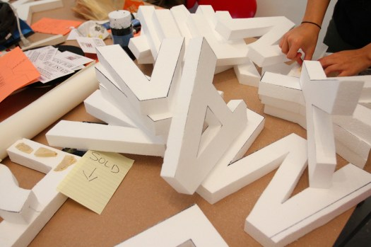 Styrofoam letters, white walls, night time guerilla art (9)