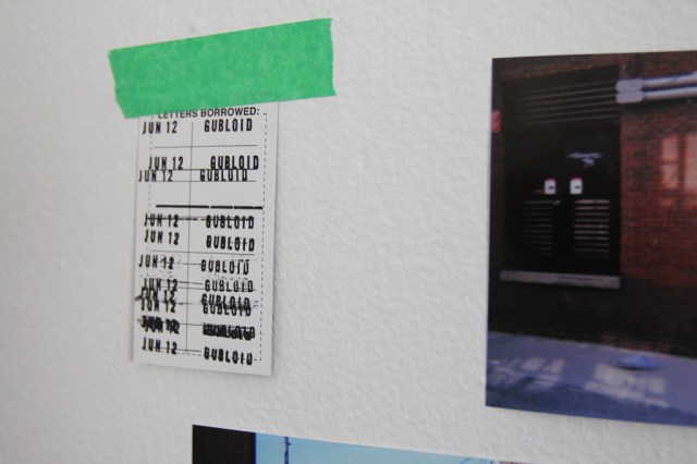 Exhibition design, photographs, tape, and negatives (2)