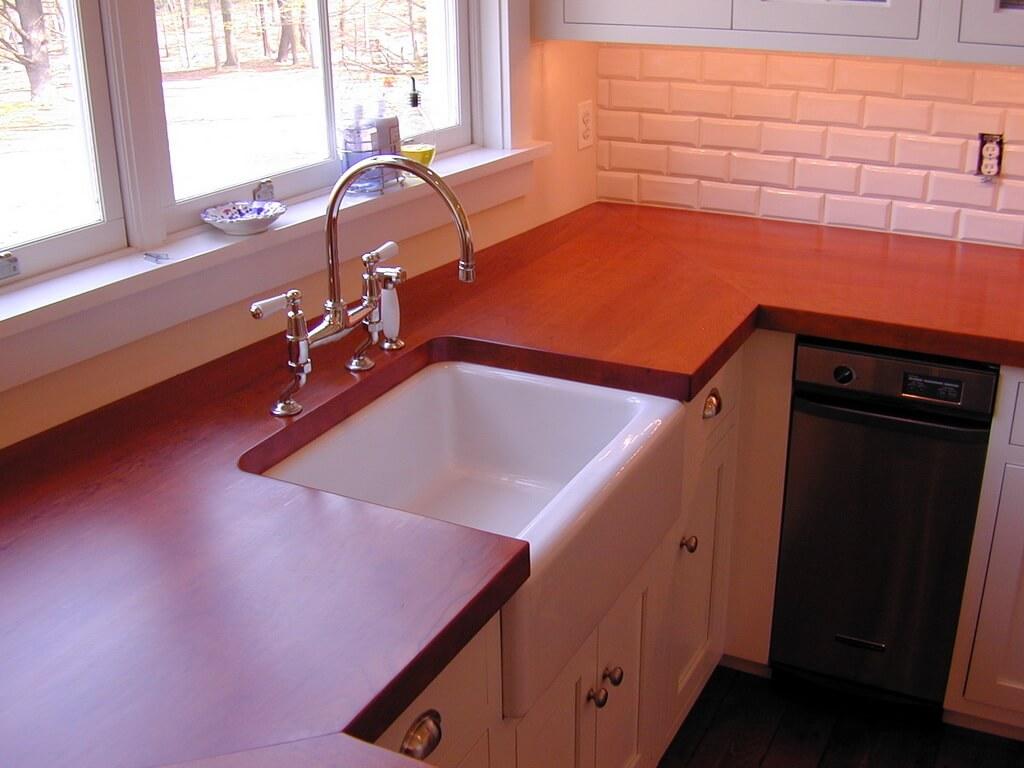 classic white kitchen white kitchen sink Cherry Wide Plank Wood Countertop in a White Kitchen