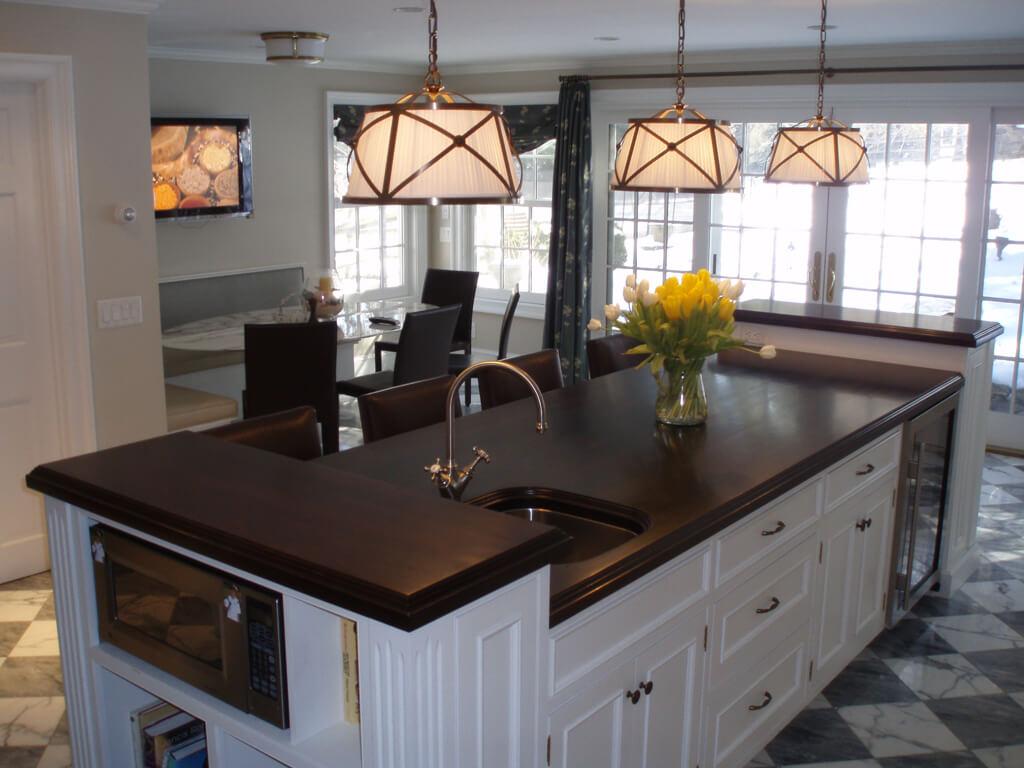bi level kitchen island with wide plank walnut wood countertop