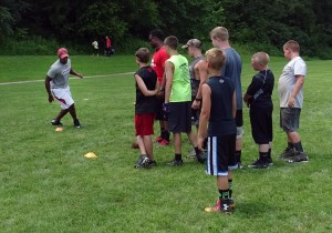 Former Buckeyes work with youth at football camp