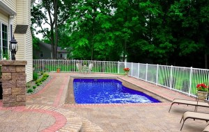 sweet-simple-swimming-pool-design-with-white-iron-fence-natural-swimming-pool-designs-600x380