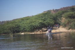 A bulleteer making his way through a water crossing while on the way back from tighra dam. This shallow river is actually a result of water seeping from the crack in the dam