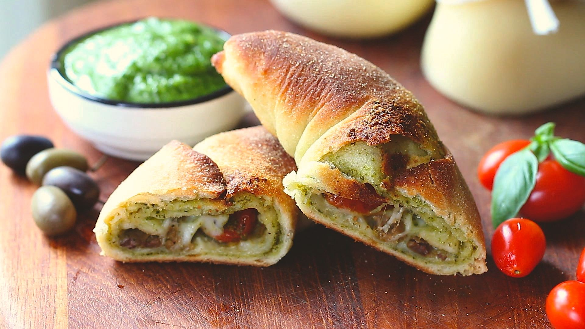Mini Calzoni With Basil Pesto Provolone Cheese And Cherry