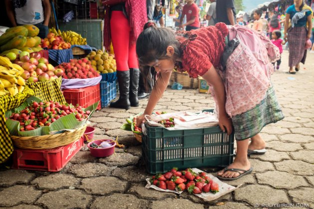 Young worker in market in Antigua, Guatemala. Photo copyright Rudy Giron, all rights reserved.