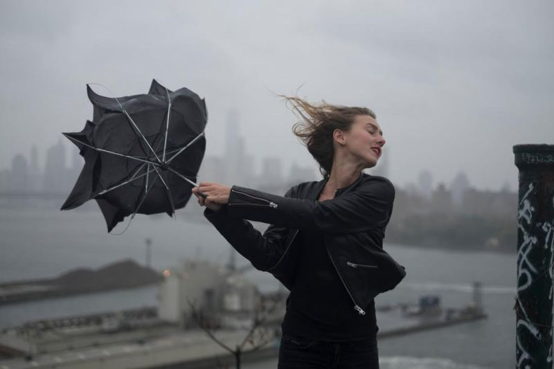 USA. Brooklyn, NY. 2015. Dasha Gavrylenko goes up on the roof of the 'kibbutz' appartment building to watch hurricane Joaquin.