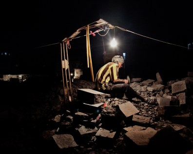 Agust 2010 - Ibb - Worker at night during ramadam .