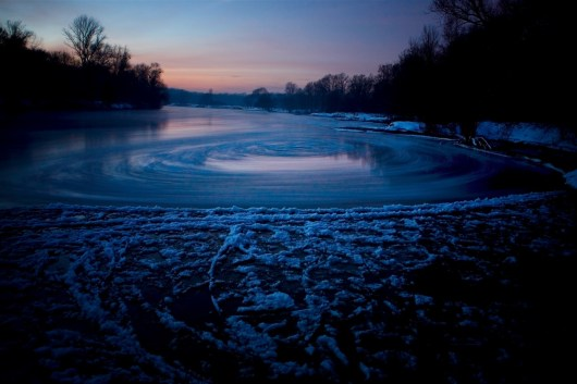 River Odra near Wroclaw, Poland in winter. A small bay where current cause rotation of ice particles.