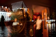 Wroclaw, Poland. A barmaid finishes her day of work on a pleasure boat.
