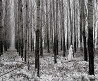 Johanna, a nun of the Order of Premontre walks to her convent through a forest outside of Zsambek, North Hungary.