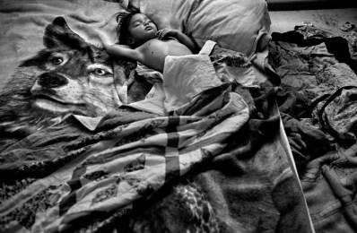 Wikuchela Waters sleeps on his parentÕs bed, Allen, Pine Ridge Reservation. (2010)