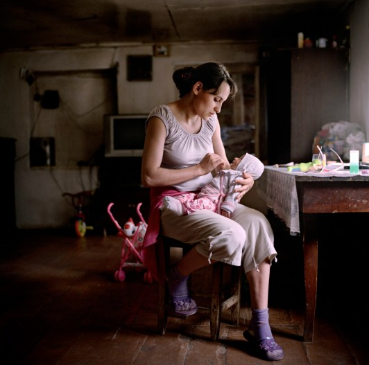 "19 year old Narine Hakobyan at home with her new born daughter Inna, in Kolatak village where she lives with her husbands family. Nagorno Karabakh, 2011. Narine and her husband Suren have received approximately €1150 (600,00 ad) in wedding and baby payments as part of the government's ""Birth Encouragement Program""."