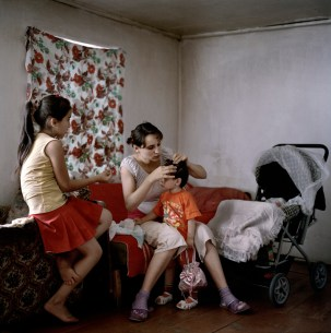"19 year old Narine Hakobyan combs her 2 year old daughter Angelina's hair at home in Kolatak village, where she lives with her husbands family, including her young sister-in-law, Lilit (left). Nagorno Karabakh, 2011. Narine and her husband Suren have received approximately €1150 (600,00 ad) in wedding and baby payments as part of the government's ""Birth Encouragement Program""."