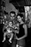 Giovanni Morales (32) and his wife Isamar Orellana (20) and their new born Grace (3 months). Giovanni is a gang member of the Mara Salvatrucha. He has been in prison four times and started to realize that this was not the life he wanted. He is now fighting to be accepted by society and live a normal life. He is working at a bakery for gang members in Buenos Aires, a rough neighborhood of San Salvador. The bakery is an initiative to learn gang members a profession and enable them to earn their own money. El Salvador is often mentioned as the most Americanized country in the Americas. One third of its population lives in the USA. El Salvador also has most murders per capita in the world. Violence stems from the brutal civil war and the gangs, gangs who originated in the US. When the peace accords were signed in 1992 the US deported many Salvadorians back to El Salvador: the start of the gangs 'Mara Salvatrucha' and '18'. Salvador's economy is heavily depending on remesas; money that Salvadorians in the US send to their families in El Salvador.