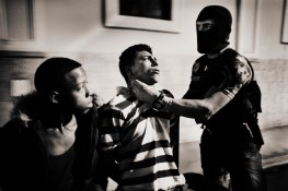 Juvenile detention Saul and Walter David Martinez Quilez in district 1 of Tegucigalpa for possession of marijuana. In the image detainees are beaten by police.