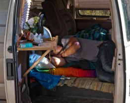 A trimmer takes a nap in his makeshift home in California's Mendocino County.