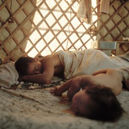 Mongolia, Gobi, Omongov, 2012 Tuvshinbayar is sleeping with his son Tuyshintugs after a working morning with his camels