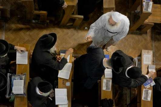 A pilgrim asks for change to help finance his bus fare back to Kiev. ticket. Thousands travel without accommodation or a return ticket to Israel or NY and rely on charity to support their trip. Approximately 30,000 religious Jews make an annual pilgrimage to the tomb of Breslover Rabbi Nachman's tomb in Uman, Ukraine for Rosh Hashanah. The pilgrimage is unique because it attracts men from across the spectrum of Judaism. In making the pilgrimage, they believe that Rabbi Nachman will intercede on their behalf on Yom Kippur, the Jewish day of atonement.