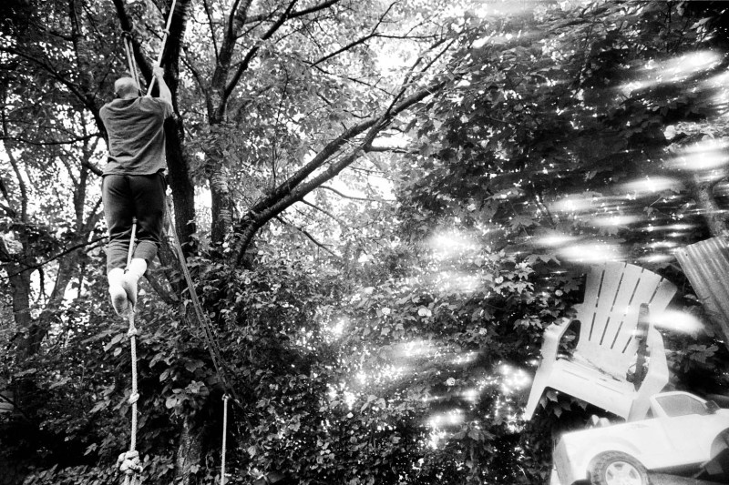 Collin Watt climbs a rope in his backyard. He is karate teacher for the visually impaired and waiter at the restaurant Dans le Noir, in midtown Manhattan. Queens, New York, July 10, 2012